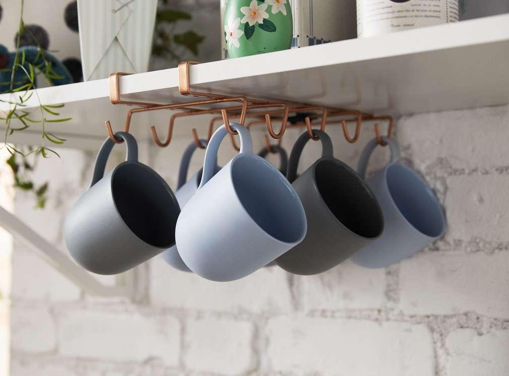 Изображение на Spice & Soul® чаши, подредени на закачалки за чаши