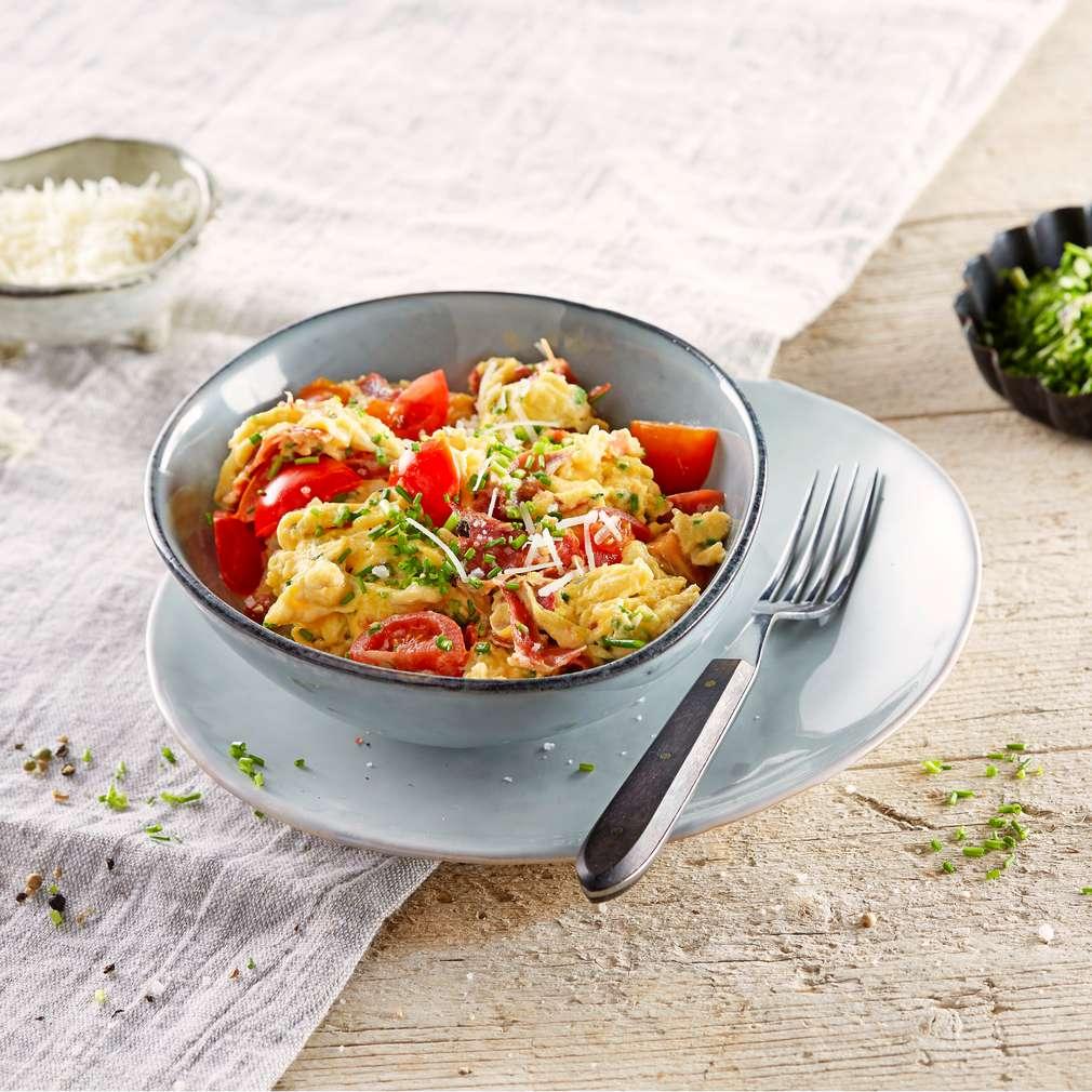 Abbildung des Rezepts Parmesanrührei mit Tomaten und Parmaschinken