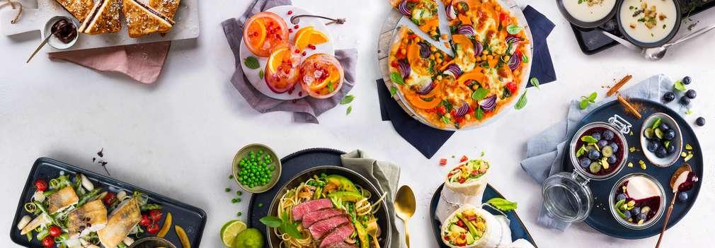 Изображение на маса, препълнена с вкусни ястия