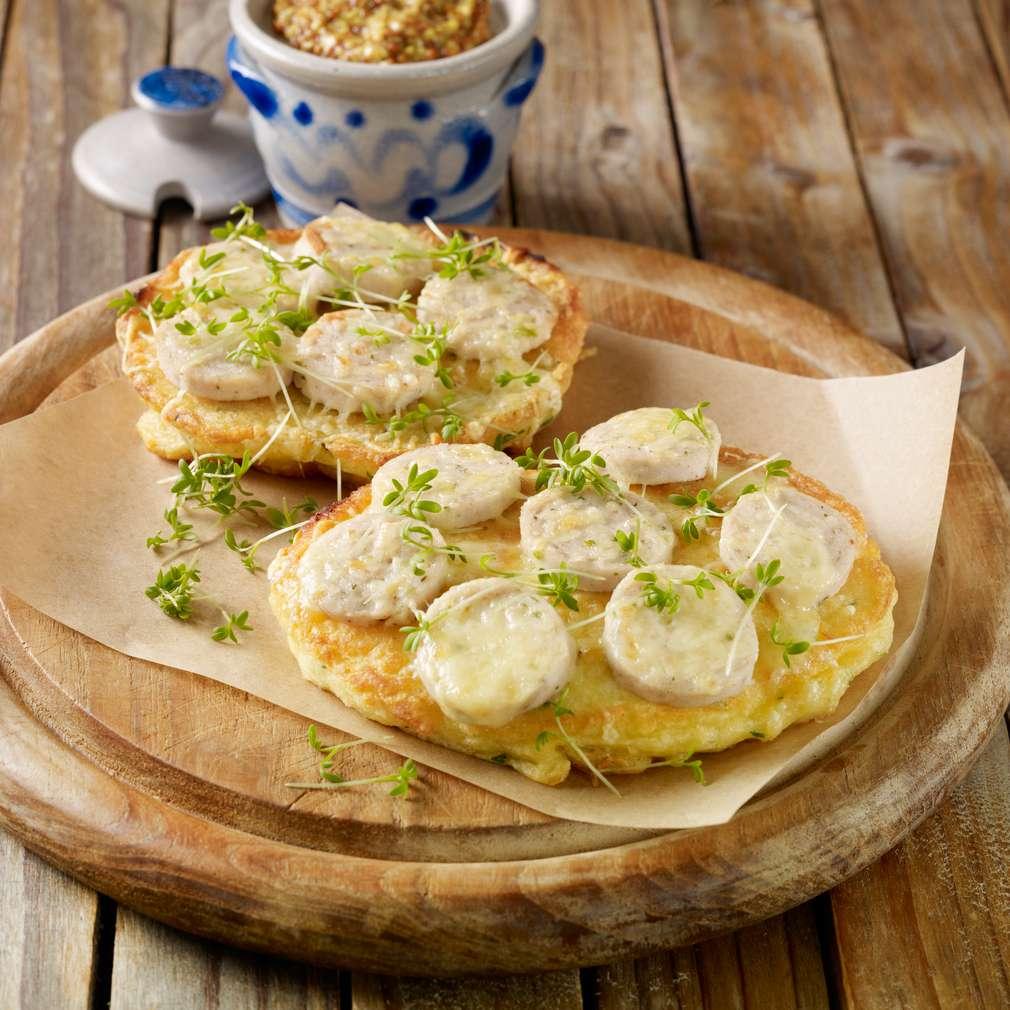 Abbildung des Rezepts Kartoffelpuffer mit Weißwurst-Käse-Topping