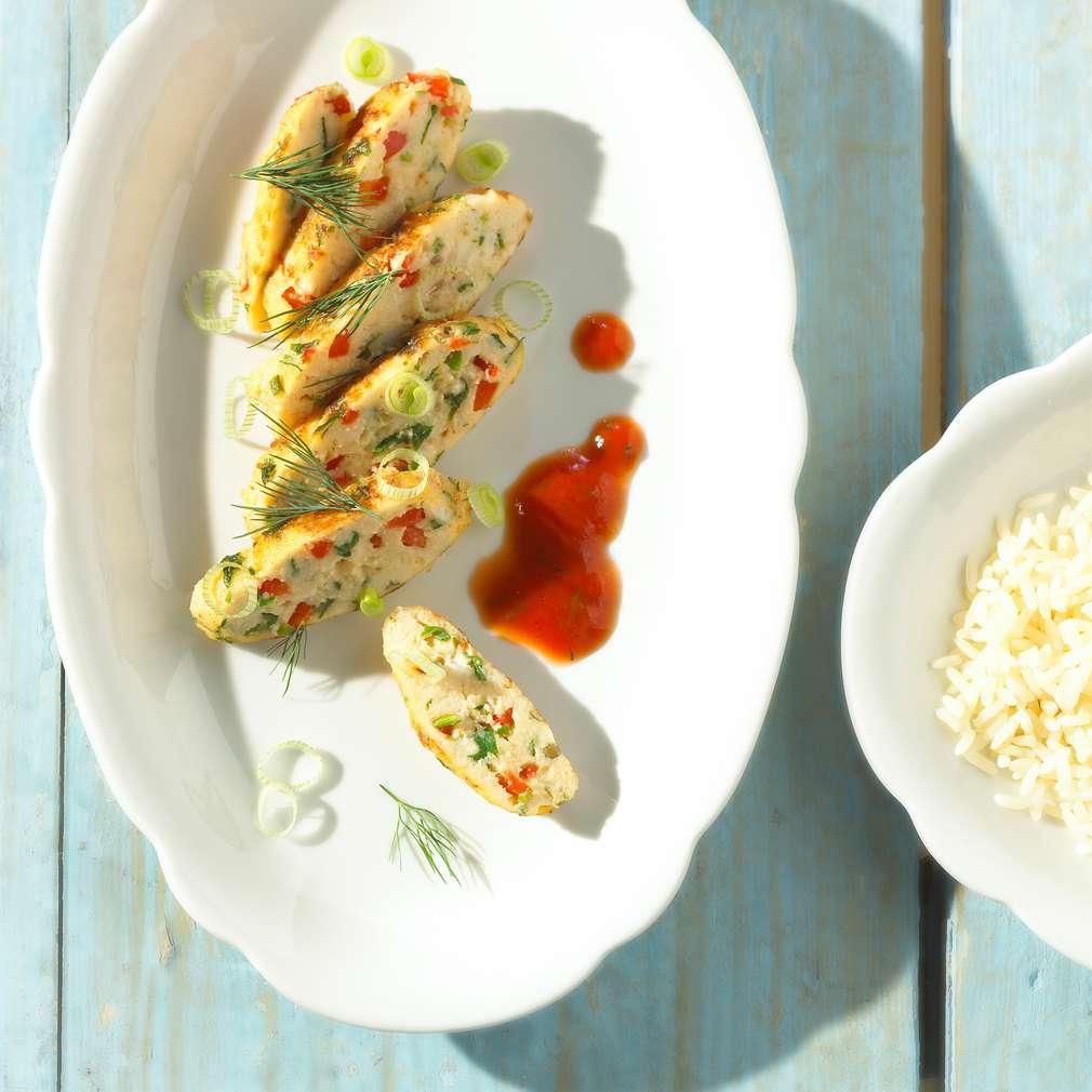 Zobrazit Pikantní rybí frikadelky v rajské omáčce receptů