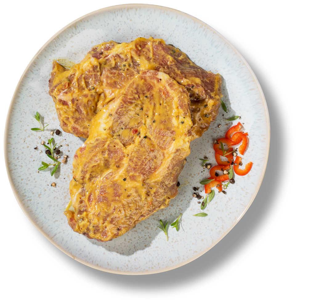 Abbildung des Angebots Nackensteak vom Schwein, mit Pfeffer-Senf Marinade, würzig mariniert